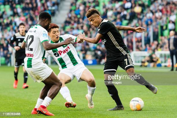 Deyovaisio Zeefuik of FC Groningen Ritsu Doan of FC Groningen David Neres of Ajax during the Dutch Eredivisie match between FC Groningen and Ajax...
