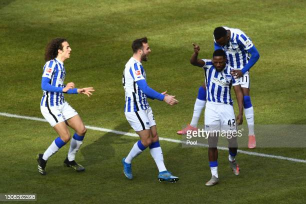 Deyovaisio Zeefuik of Hertha Berlin celebrates with team mates after scoring their side's first goal during the Bundesliga match between Hertha BSC...