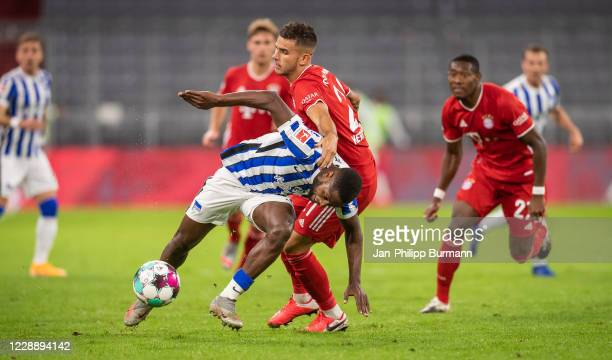 Deyovaisio Zeefuik of Hertha BSC and Lucas Hernandez of FC Bayern Muenchen during the Bundesliga match between FC Bayern Muenchen and Hertha BSC at...