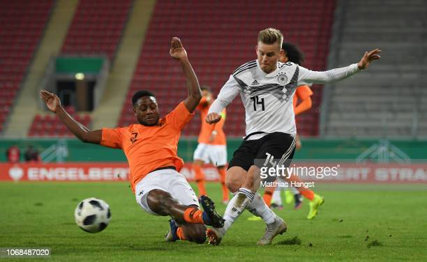Deyovaisio Zeefuik of Holland challenges Maximilian Mittelstaedt of Germany during the International Friendly match between Germany U21 and Holland...