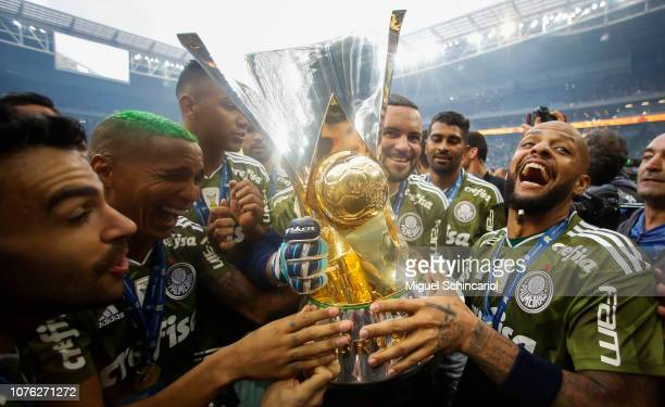 Deyverson and Felipe Melo of Palmeiras hold the trophy after winning the Brasileirao 2018 after the match against Vitora at Allianz Parque on...