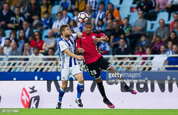 Deyverson Brum of Deportivo Alaves duels for the ball with Asier Illarramendi of Real Sociedad during the La Liga match between Real Sociedad de...