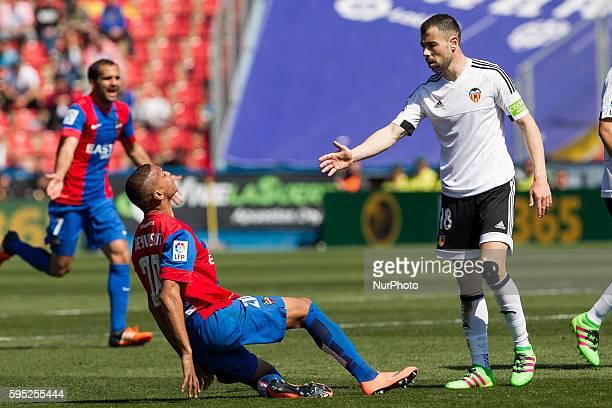 Deyverson Brum Silva Acosta of Levante UD and 18 Javi Fuego of Valencia CF during la liga match between Levante UD and Valencia CF at Ciutat de...