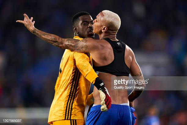 Deyverson of Getafe CF argues with Bruno Varela of AFC Ajax during the UEFA Europa League round of 32 first leg match between Getafe CF and AFC Ajax...