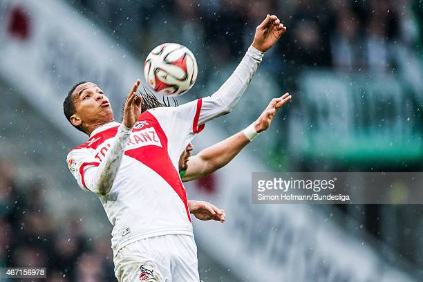 Deyverson of Koeln jumps for a header with Sebastian Proedl of Bremen during the Bundesliga match between 1 FC Koeln and Werder Bremen at...