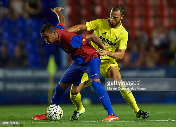 Deyverson of Levante and Pablo Iniguez of Villarreal battle for the ball during a Pre Season Friendly match between Levante UD and Villarreal CF at...