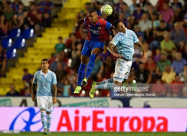 Deyverson of Levante wins a header with Augusto Matias Fernandez of Celta de Vigo during the La Liga match between Levante UD and Real Club Celta de...