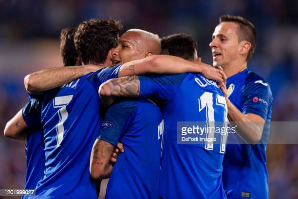 Deyverson Silva of Getafe CF celebrates after scoring his team's first goal with teammates during the UEFA Europa League Round of 32 first leg match...