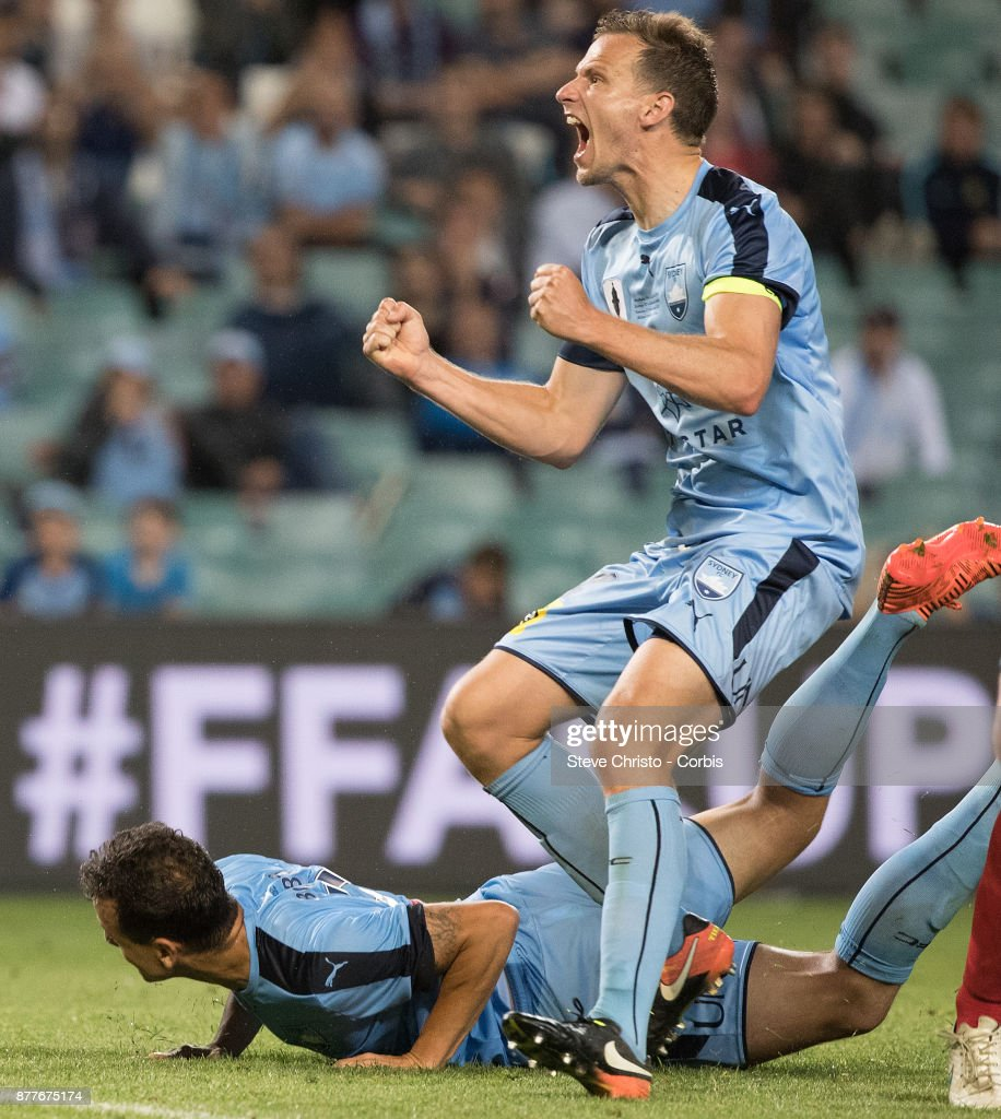 Deyvison Rogerio da Silva, Bobo (lying down)and Alexander Wilkinson of Sydney FC celebrate Bobo scoring the winning goal during the FFA Cup Final match between Sydney FC and Adelaide United at Allianz Stadium on November 21, 2017 in Sydney, Australia.
