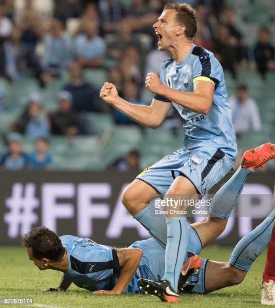 Deyvison Rogerio da Silva Bobo and Alexander Wilkinson of Sydney FC celebrate Bobo scoring the winning goal during the FFA Cup Final match between...