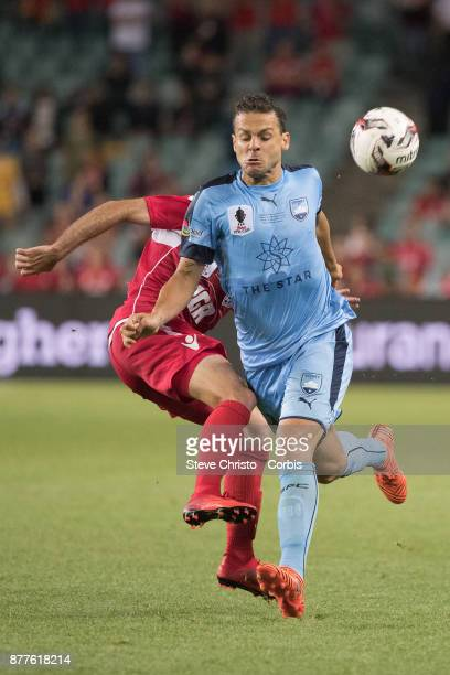 Deyvison Rogerio da Silva Bobo of Sydney FC is challenged for the ball by Adelaide's Nikola Mileusnic during the FFA Cup Final match between Sydney...