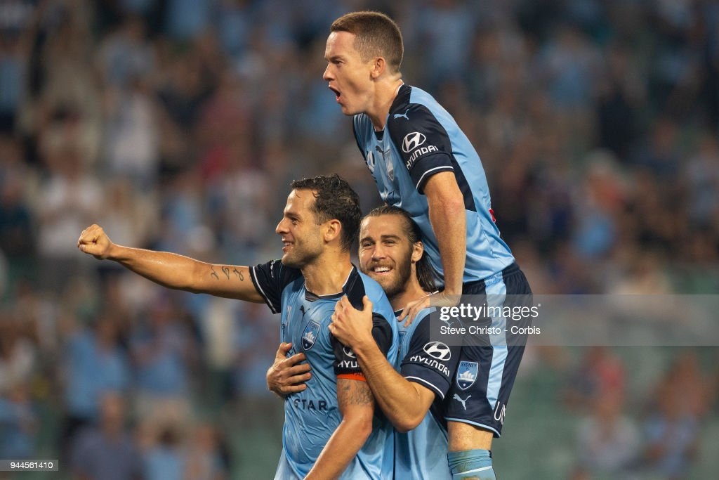 Deyvison Rogerio da Silva, Bobo of the Sydney celebrates scoring his second goal with Joshua Brillante and Brandon O'Neill during the round 26 A-League match between Sydney FC and Adelaide United at Allianz Stadium on April 8, 2018 in Sydney, Australia.