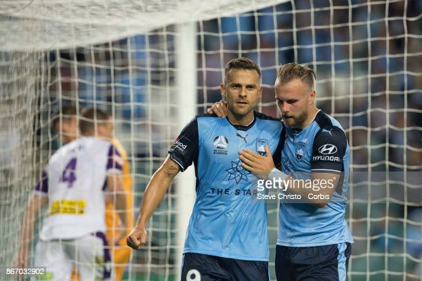 Deyvison Rogério da Silva celebrates scoring a penalty with teammate Jordy Buijs during the round four ALeague match between Sydney FC and the Perth...