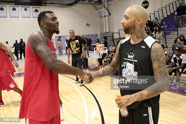 Dez Bryant and Joe Budden attend Gridiron Celebrity Hoops XVL at Nat Holman Gymnasium at City College of New York on February 1 2014 in New York City