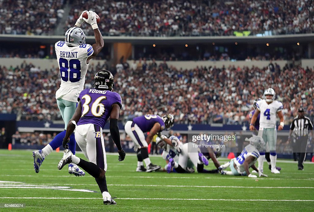 Dez Bryant #88 catches a pass from Dak Prescott #4 of the Dallas Cowboys during the third quarter against the Baltimore Ravens at AT&T Stadium on November 20, 2016 in Arlington, Texas.