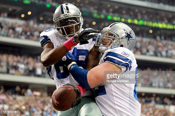 Dez Bryant of the Dallas Cowboys and Jason Witten celebrate a touchdown against the Detroit Lions during the first quarter at Cowboys Stadium on...