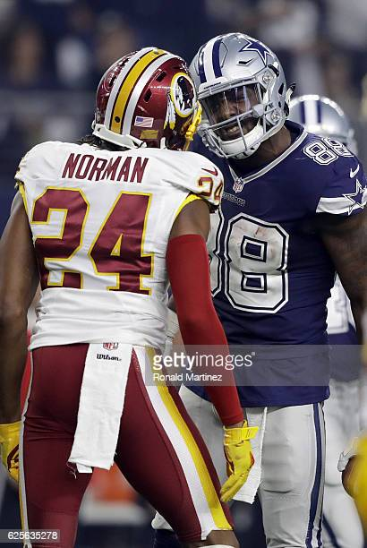 Dez Bryant of the Dallas Cowboys argues with Josh Norman of the Washington Redskins after catching a pass in their game at ATT Stadium on November 24...
