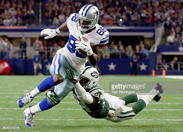 Dez Bryant of the Dallas Cowboys carries the ball and scores a touchdown against Darrelle Revis of the New York Jets in the second quarter at ATT...