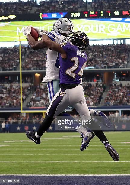 Dez Bryant of the Dallas Cowboys catches a touchdown pass from quarterback Dak Prescott during the third quarter against the Baltimore Ravens at ATT...