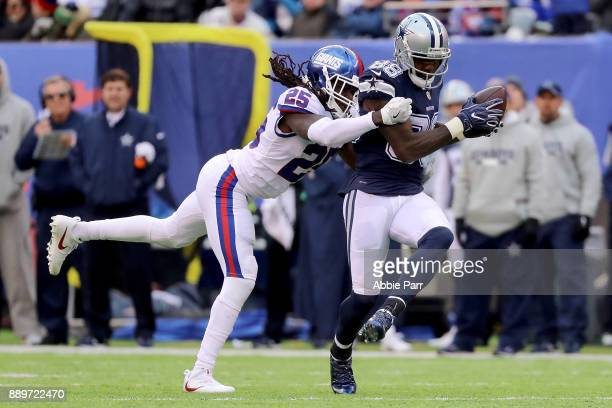 Dez Bryant of the Dallas Cowboys catches the ball against Brandon Dixon of the New York Giants for what would be a 50 yard touchdown in the third...