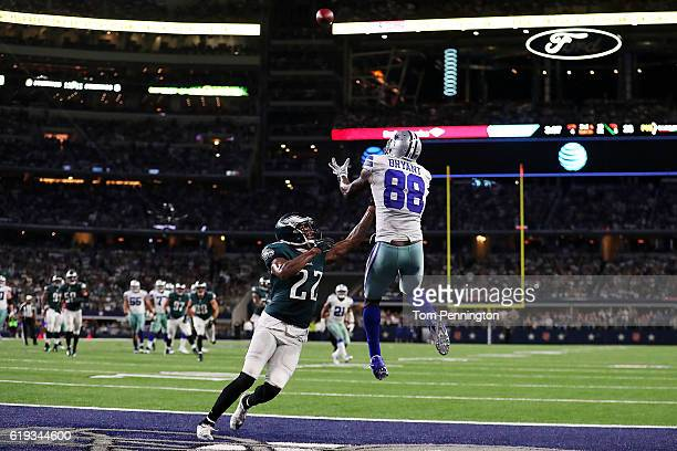Dez Bryant of the Dallas Cowboys catches the ball for a touchdown over the defense of Nolan Carroll of the Philadelphia Eagles in the fourth quarter...