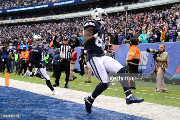 Dez Bryant of the Dallas Cowboys celebrates after scoring a 50 yard touchdown against the New York Giants during the fourth quarter in the game at...