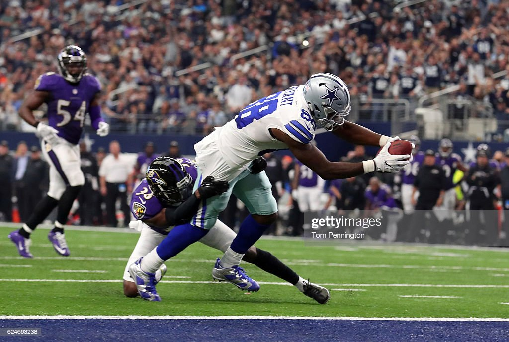 Dez Bryant #88 of the Dallas Cowboys dives for the end zone to score a touchdown after catching a pass from Dak Prescott during the third quarter against the Baltimore Ravens at AT&T Stadium on November 20, 2016 in Arlington, Texas.