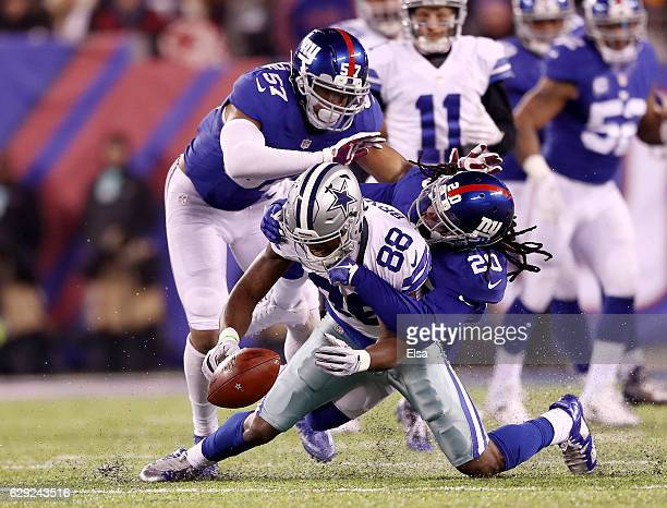 Dez Bryant of the Dallas Cowboys fumbles the ball as Janoris Jenkins and Keenan Robinson of the New York Giants make the tackle in the fourth quarter...
