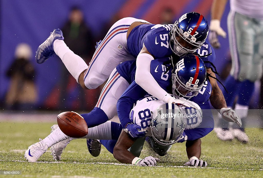 Dez Bryant #88 of the Dallas Cowboys fumbles the ball as Janoris Jenkins #20 and Keenan Robinson #57 of the New York Giants make the tackle in the fourth quarter at MetLife Stadium on December 11, 2016 in East Rutherford, New Jersey