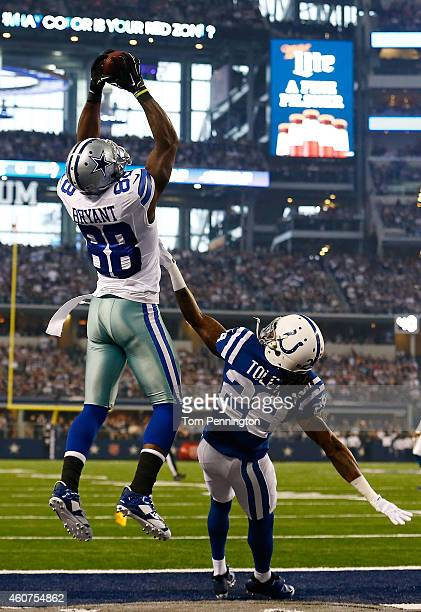 Dez Bryant of the Dallas Cowboys goes up for the catch to score a touchdown as Greg Toler of the Indianapolis Colts defends in the first half at ATT...