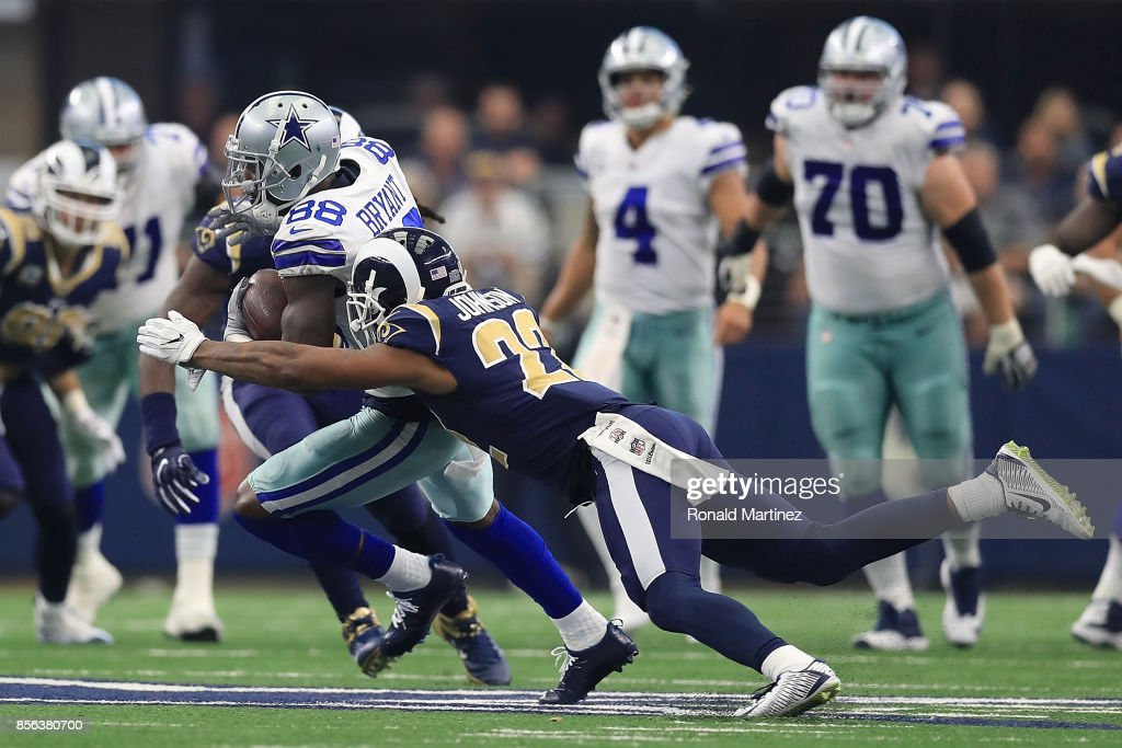 Dez Bryant Of The Dallas Cowboys Is Hit By Trumaine Johnson