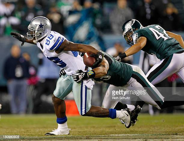 Dez Bryant of the Dallas Cowboys is tackled by Jason Babin of the Philadelphia Eagles during a game at Lincoln Financial Field on October 30 2011 in...