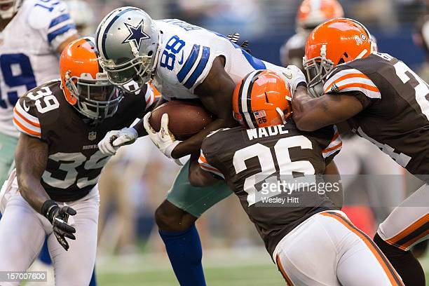 Dez Bryant of the Dallas Cowboys is tackled by Trevin Wade and Tashaun Gipson of the Cleveland Browns at Cowboys Stadium on November 18 2012 in...