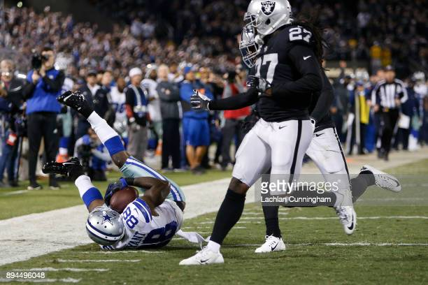 Dez Bryant of the Dallas Cowboys makes a catch at the fouryard line against the Oakland Raiders during their NFL game at OaklandAlameda County...