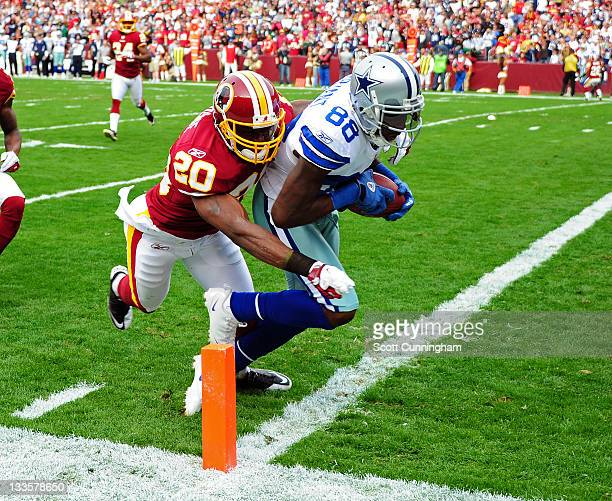 Dez Bryant of the Dallas Cowboys makes a catch for a touchdown against Oshiomogho Atogwe of the Washington Redskins at FedEx Field on November 20...