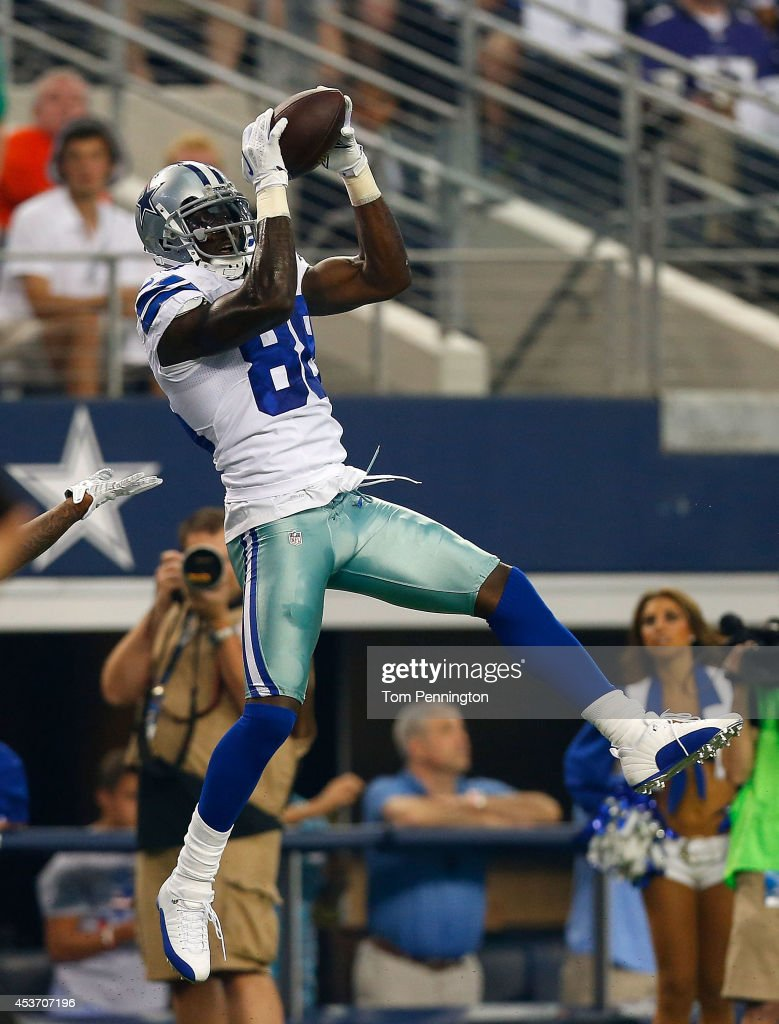 Dez Bryant #88 of the Dallas Cowboys makes the catch against the Baltimore Ravens in the first half of their preseason game at AT&T Stadium on August 16, 2014 in Arlington, Texas.