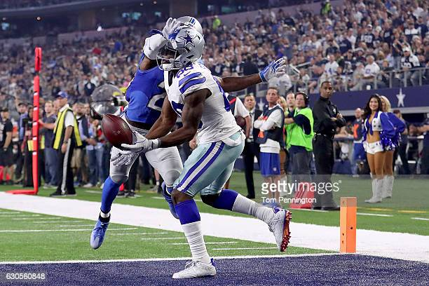 Dez Bryant of the Dallas Cowboys pulls in a touchdown pass against Johnson Bademosi of the Detroit Lions in the second quarter at ATT Stadium on...