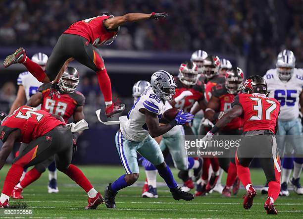 Dez Bryant of the Dallas Cowboys runs after catching a pass during the second quarter against the Tampa Bay Buccaneers at ATT Stadium on December 18...