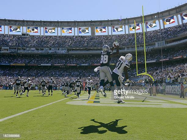 Dez Bryant of the Dallas Cowboys scores a touchdown against the San Diego Chargers on September 29 2013 at Qualcomm Stadium in San Diego California