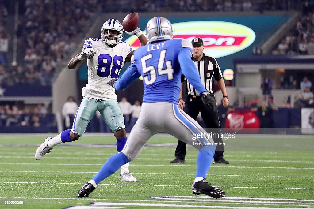 Dez Bryant #88 of the Dallas Cowboys throws a touchdown pass to Jason Witten #82 of the Dallas Cowboys against DeAndre Levy #54 of the Detroit Lions in the third quarter at AT&T Stadium on December 26, 2016 in Arlington, Texas.