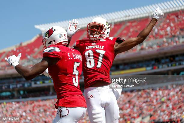 Dez Fitzpatrick of the Louisville Cardinals celebrates with Seth Dawkins of the Louisville Cardinals after he scored a touchdown against the Kent...