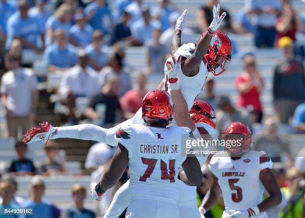 Dez Fitzpatrick of the Louisville Cardinals celebrates with teammates after scoring a touchdown against the North Carolina Tar Heels during the game...