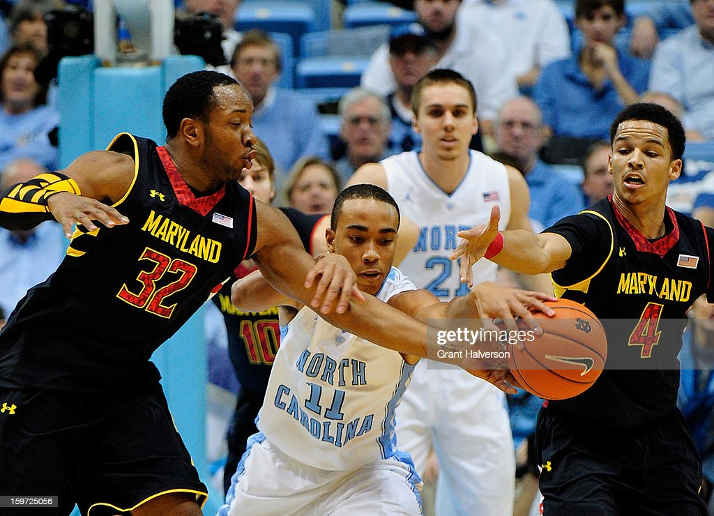 Dez Wells #32 and Seth Allen #4 of the Maryland Terrapins battle for the ball with Brice Johnson #11 of the North Carolina Tar Heels during play at the Dean Smith Center on January 19, 2013 in Chapel Hill, North Carolina. North Carolina won 62-52.