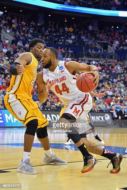 Dez Wells of the Maryland Terrapins drives against Jubril Adekoya of the Valparaiso Crusaders during the second round of the Men's NCAA Basketball...