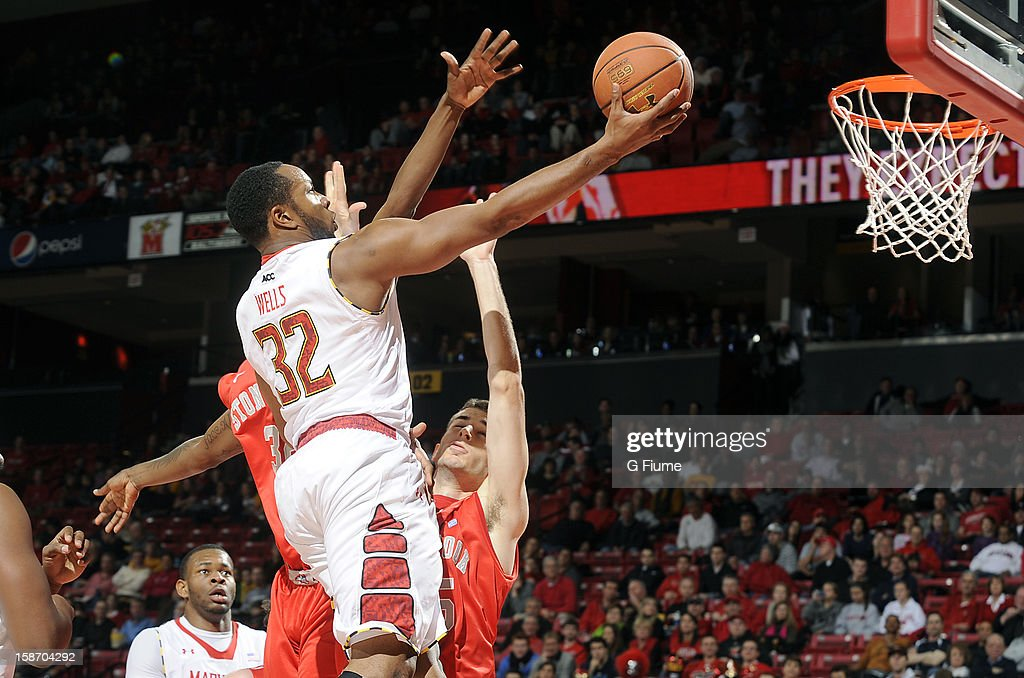 Dez Wells #32 of the Maryland Terrapins drives to the hoop against the Stony Brook Seawolves at the Comcast Center on December 21, 2012 in College Park, Maryland.