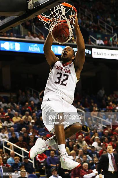 Dez Wells of the Maryland Terrapins dunks against the Wake Forest Demon Deacons during the first round of the Men's ACC Basketball Tournament at...