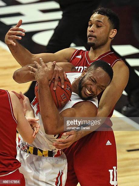 Dez Wells of the Maryland Terrapins is fouled as he rebounds by James Blackmon Jr #1 of the Indiana Hoosiers during the quarterfinal round of the...