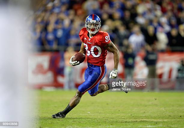 Dezmon Briscoe of the Kansas Jayhawks runs with the ball for yardage during their game against the Missouri Tigers during the game at Arrowhead...