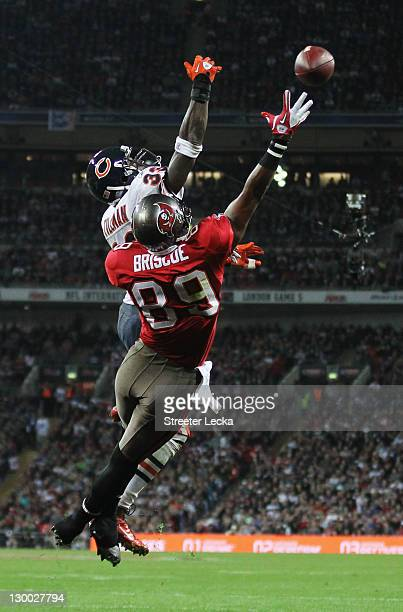 Dezmon Briscoe of the Tampa Bay Buccaneers and Charles Tillman of the Chicago Bears challenge for the ball during the NFL International Series match...