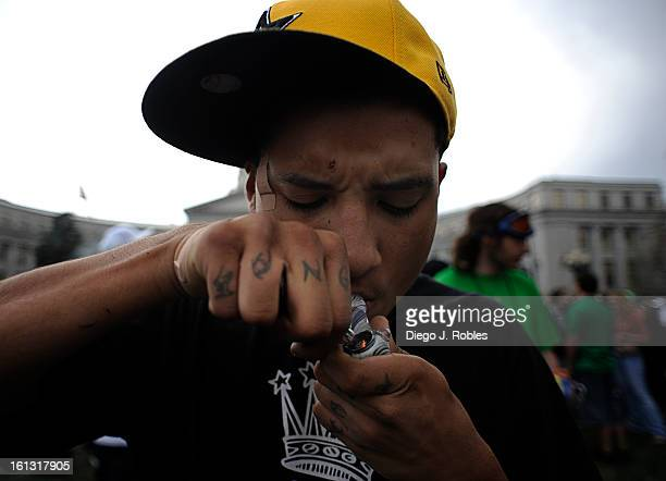 Dezyah Ramos lights up during a Civic Center Park 420 celebration on Tuesday April 20 2010 Diego James Robles The Denver Post pot rally